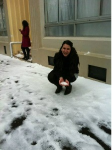 A happy Carolyn showing off the snow